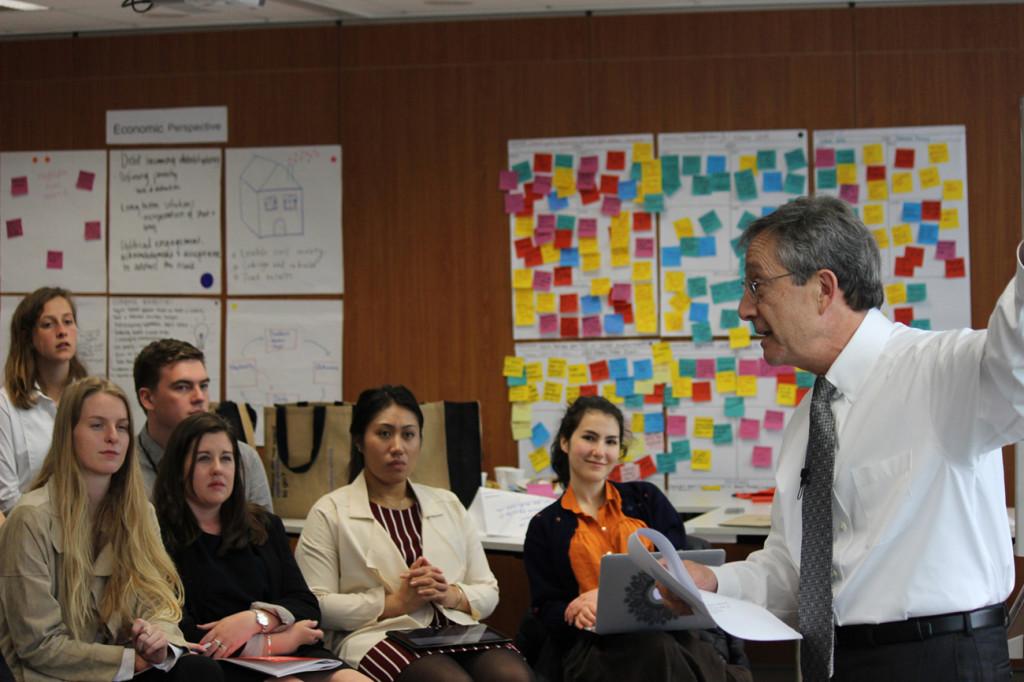 Dr Girol Karacaoglu speaks to the participants